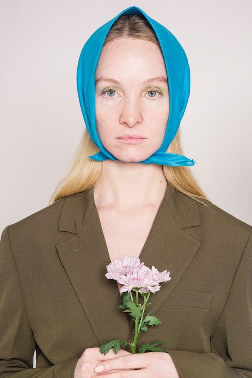 Calm woman wearing blue headscarf