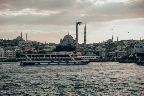Cruise ship floating on river in old city
