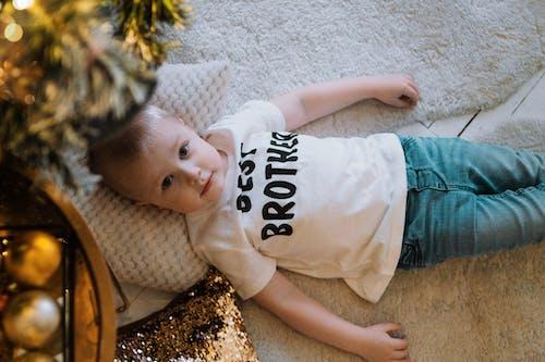 Little son lying under Christmas tree