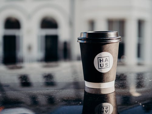 White and Black Disposable Cup