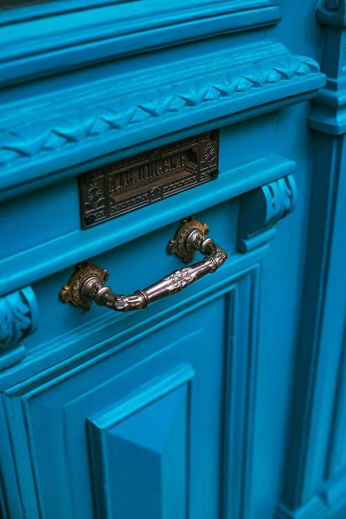 Vintage entrance door with metal doorhandle