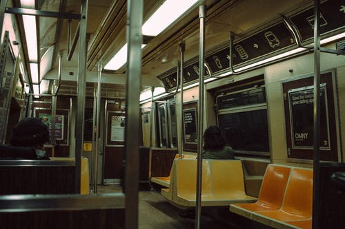 People riding in subway train
