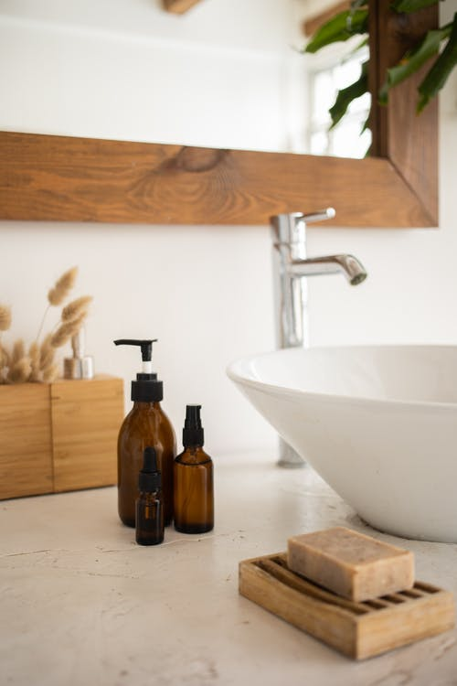 Sink with skincare products in bathroom