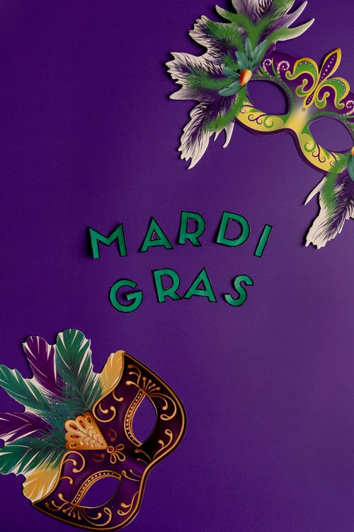 Colorful Masks And Mardi Gras Text On Purple Back