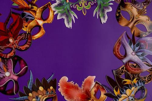 Mardi Gras Masks On Purple Background