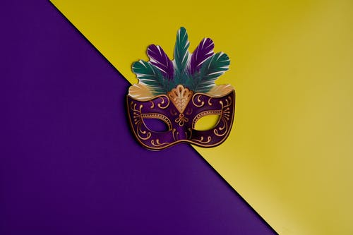 Mardi Gras Mask On Purple And Yellow Background