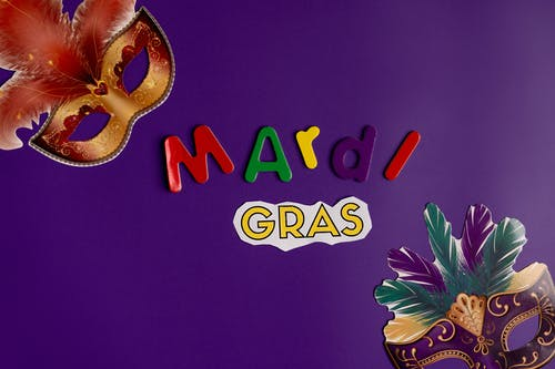 Mardi Gras Masks With Purple Background