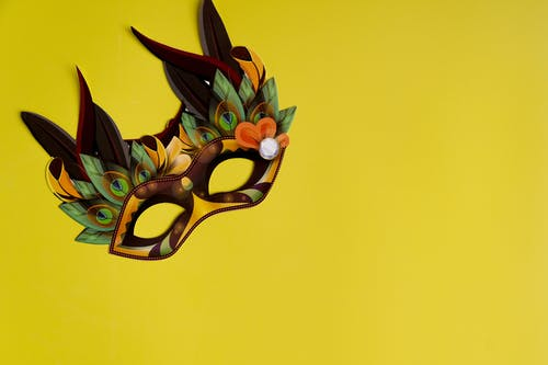 Colorful Mask On Yellow Background