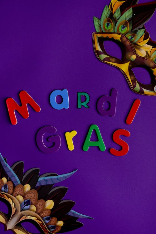 Mardi Gras Text On Purple Background