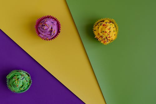 Colored Cupcakes In Colorful Background