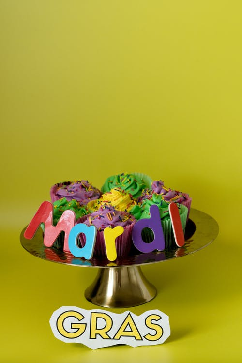 Colored Cupcakes In A Cake Stand