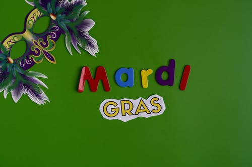 Mardi Gras Text And Mask On Green Background