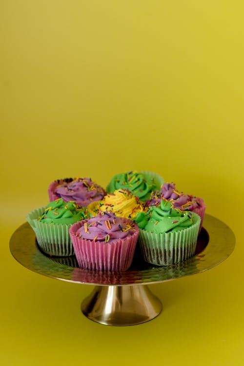 Colorful Cupcakes On A Cake Stand