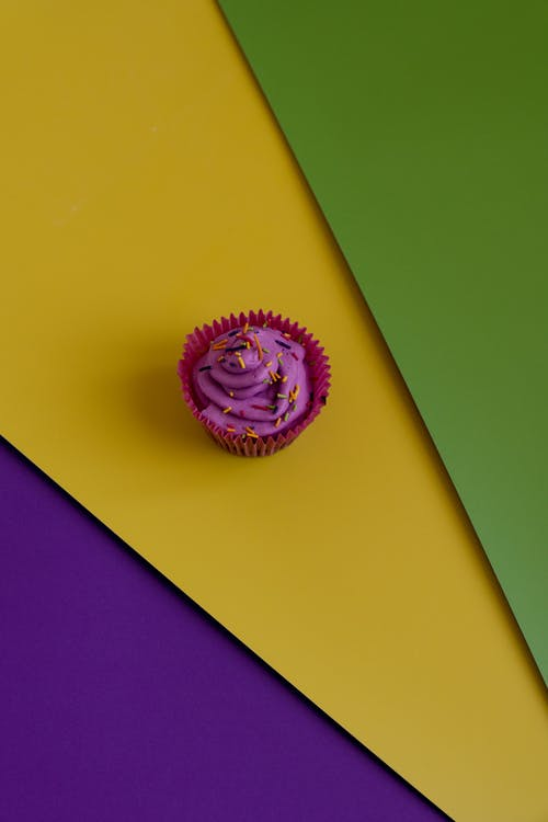 Purple Cupcake On Colorful Background