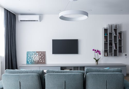 Modern interior of lounge with TV and picture on shelf