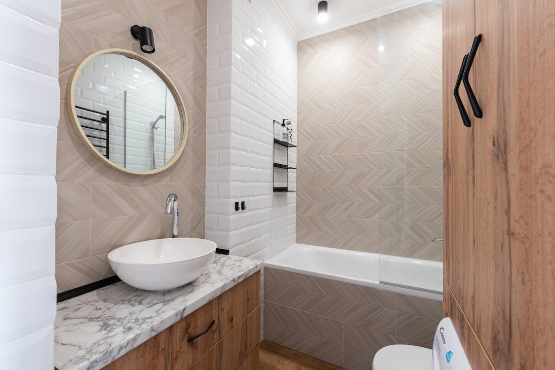 Bathroom interior with sink on counter near mirror and bath