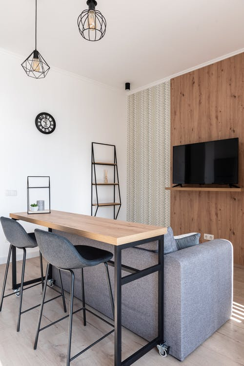 Apartment with table and chairs near couch with TV