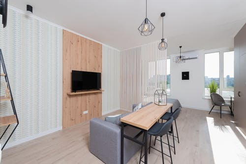 Apartment with table and chairs near couch and TV