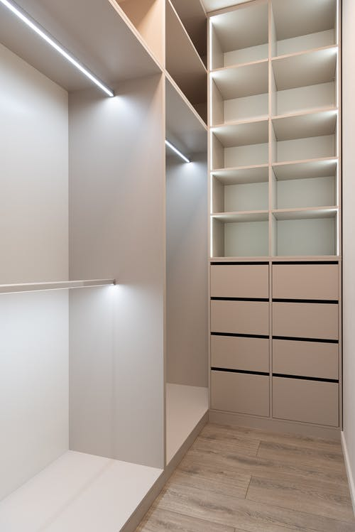 House interior with wardrobe with cabinets and shelves