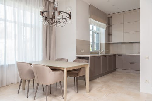Kitchen with cabinets next to table with chairs