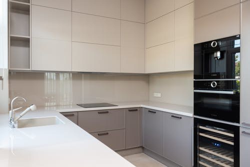 Kitchen interior with cupboards and oven near sink