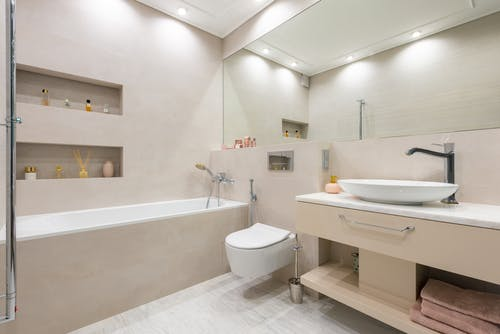 Bathroom interior with sink on counter near toilet and bath