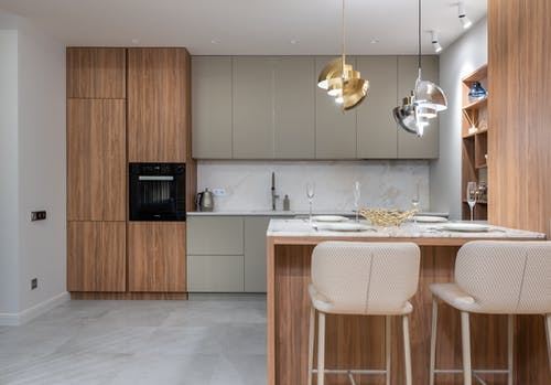 Kitchen interior with chairs and counter near cupboards
