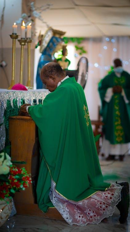 Free stock photo of a bishop praying, adult, candle