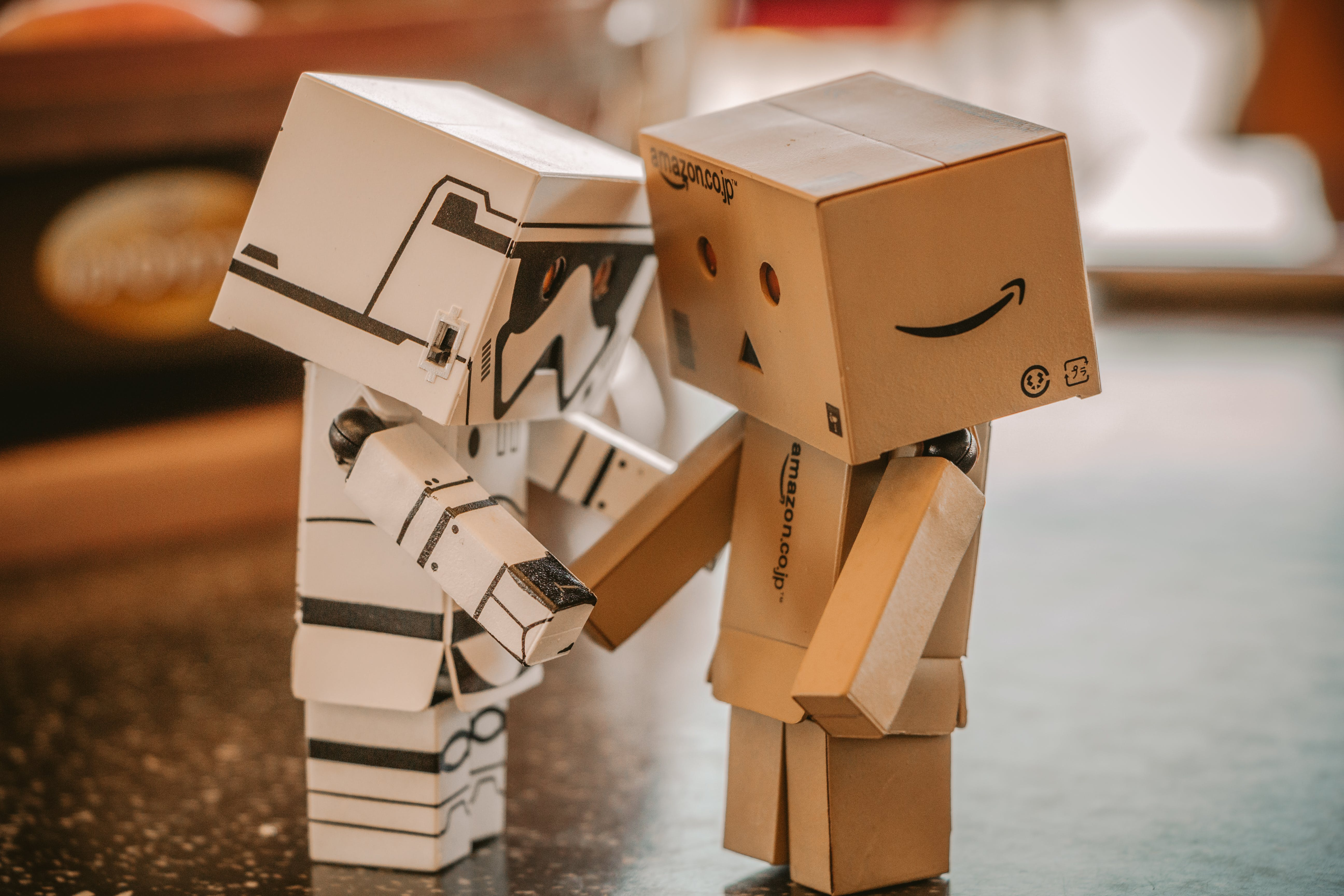 Photo of White, and Brown Cardboard Box Toy Figure