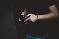 Photography of Man Holding Dslr Camera