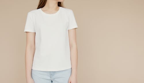Young Woman In White Crew Neck T-Shirt and Light Denim Jeans