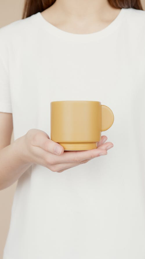 Woman In White Crew Neck T-Shirt Holding A Cup