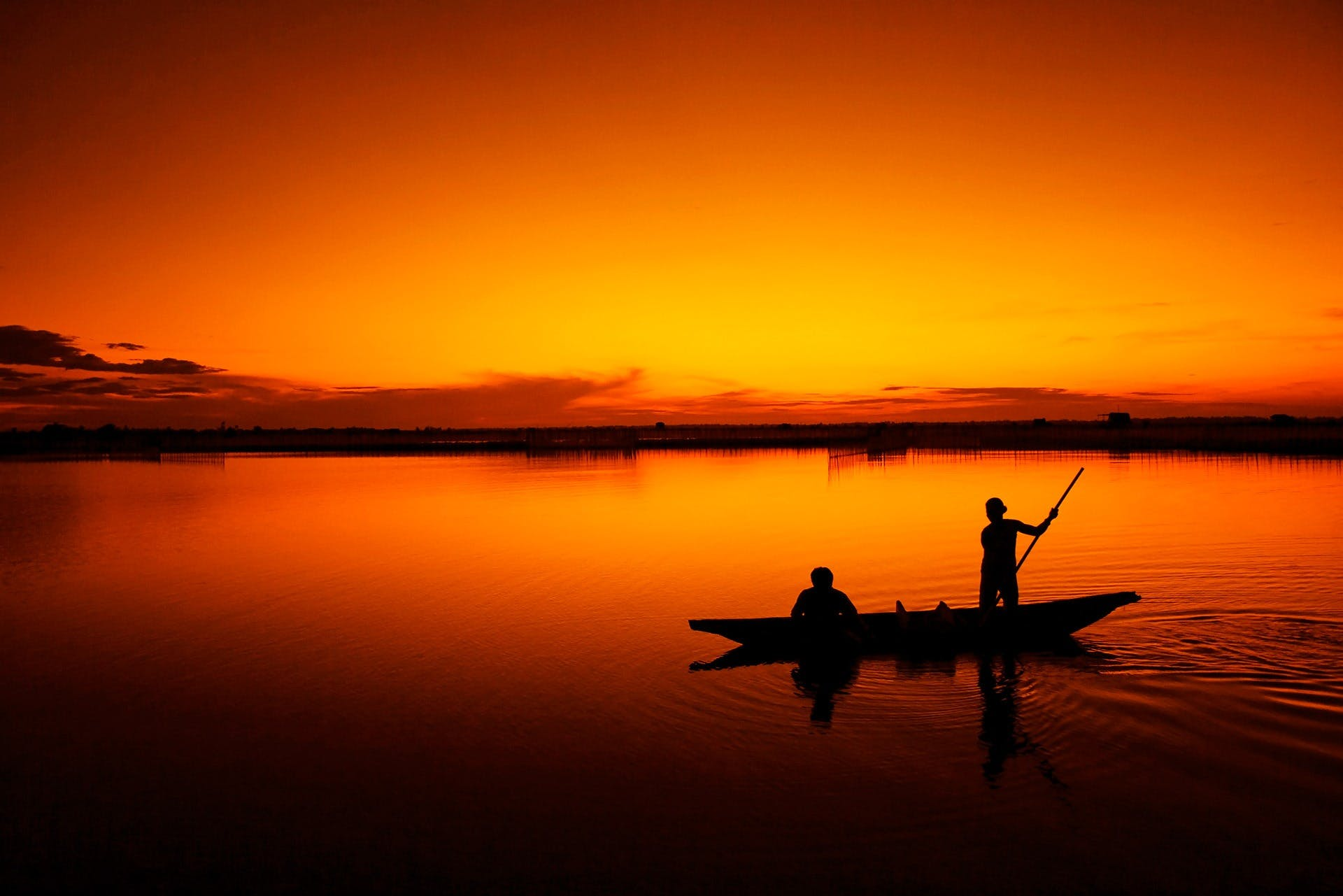 2 People on a Boat during Sunset
