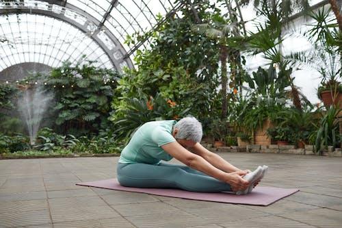 Woman Stretching Her Body Forward