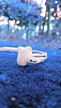Shallow Focus Photography of White Samsung Earphones
