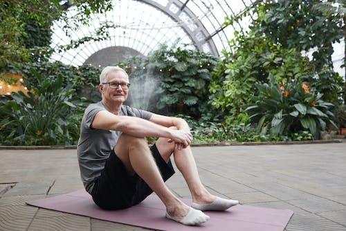Man Sitting on Yoga Mat