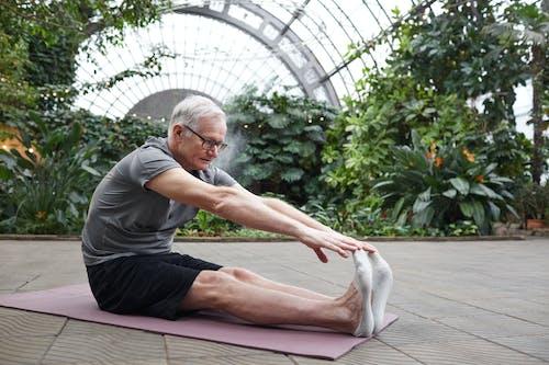Man Stretching His Body Forward