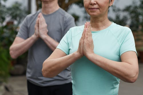 Two Persons Practicing Yoga