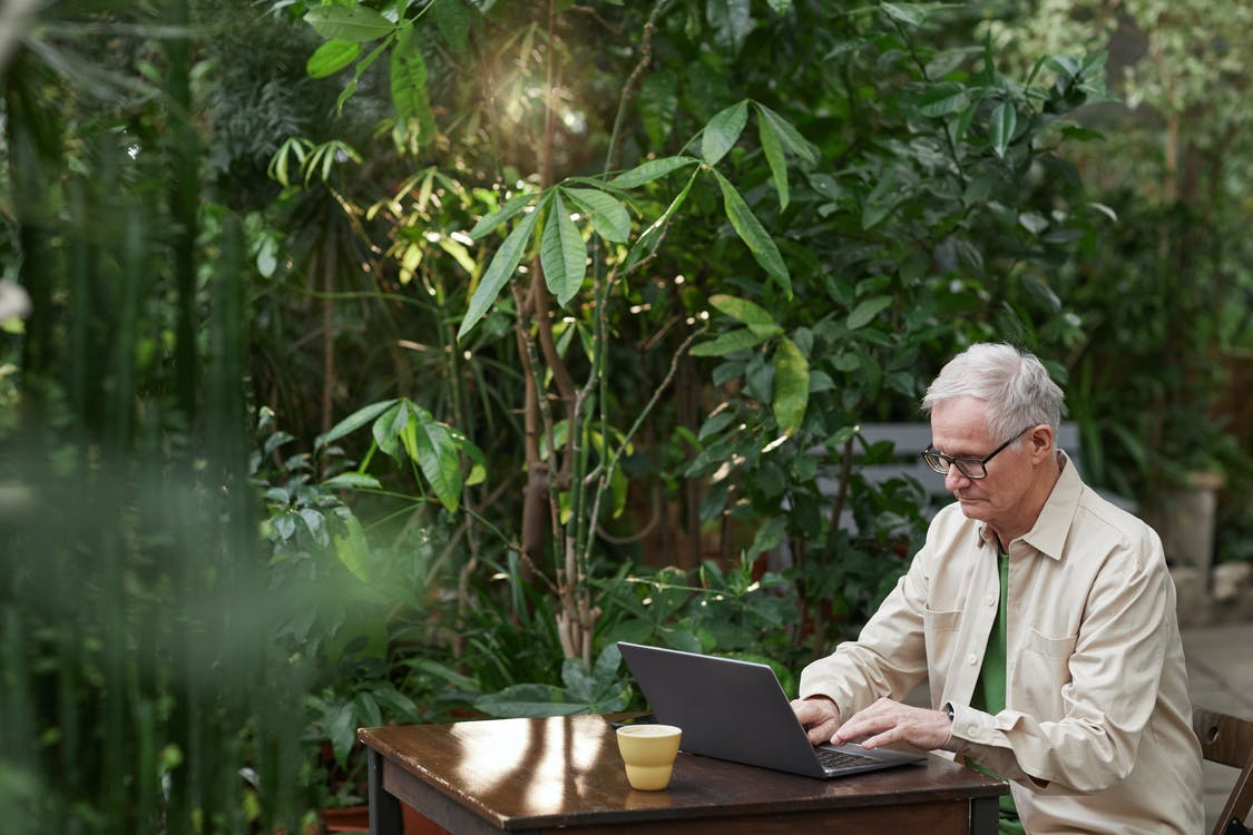 Man Busy Using His Laptop