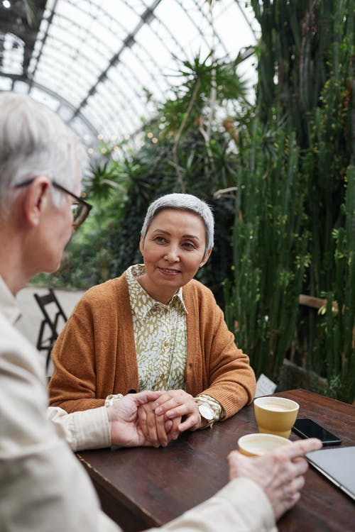 Woman Smiling While Looking at Her Man