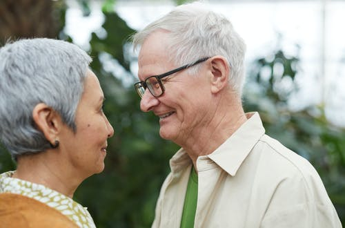Couple Smiling While Looking at Each Other