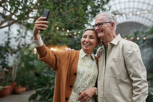 Couple Smiling While Taking a Selfie