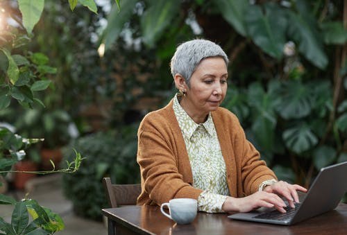Woman Busy Using Her Laptop