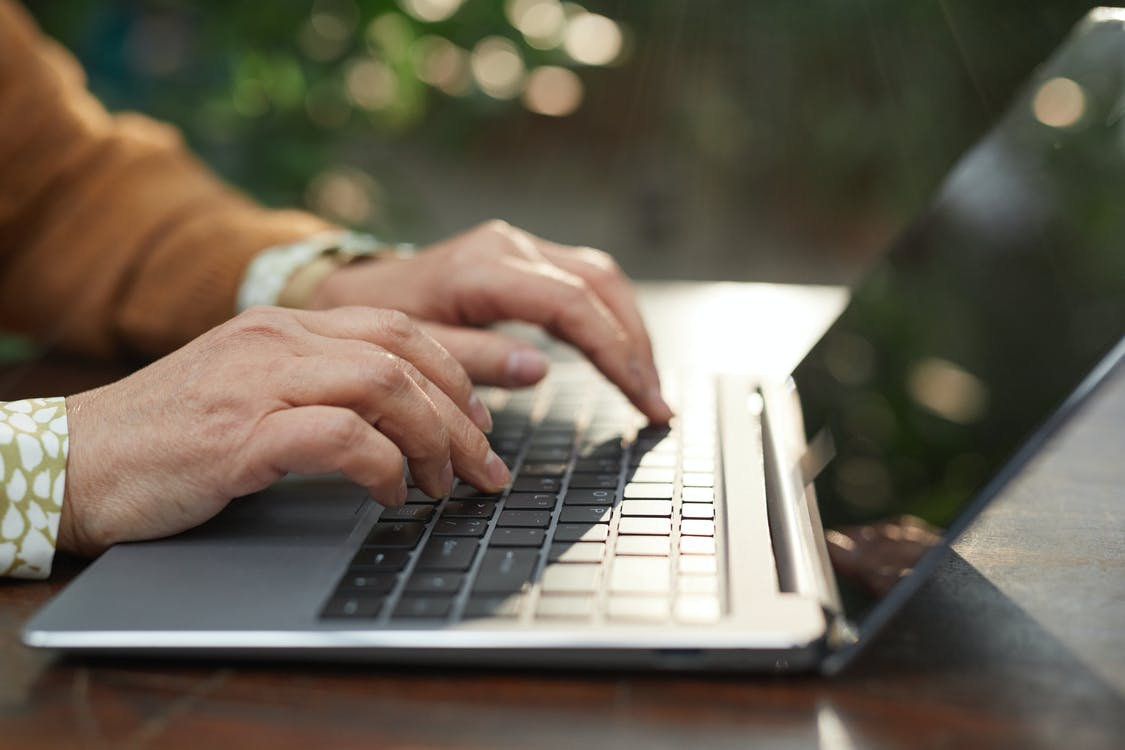 Person Using Black and Silver Laptop Computer