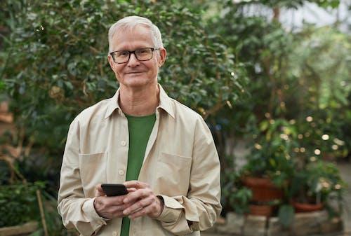 Smiling Man Wearing an Eyeglasses While Looking at the Camera