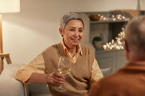 Woman Smiling While Holding Wine Glass