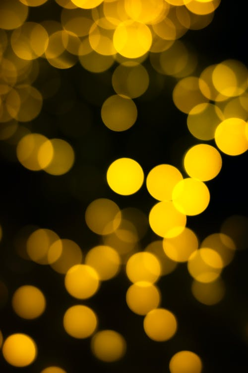 Blurred yellow lights on black background