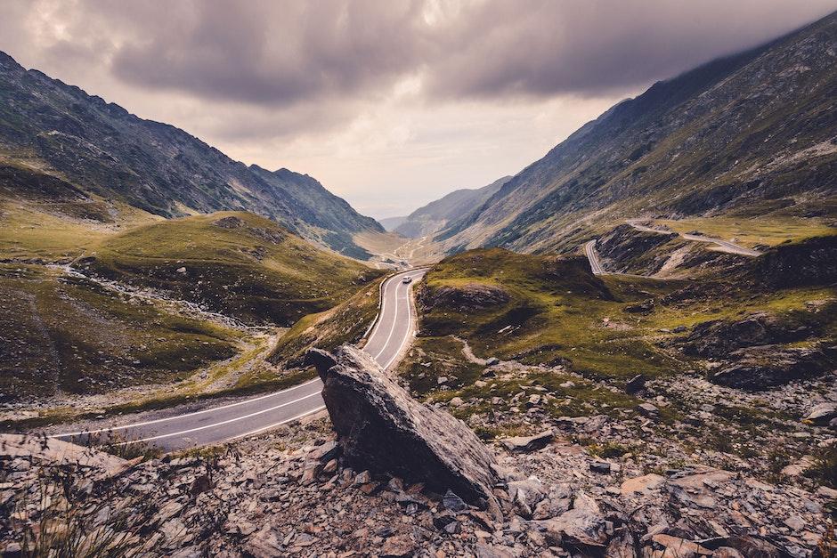 Black Car on Road Near Mountains
