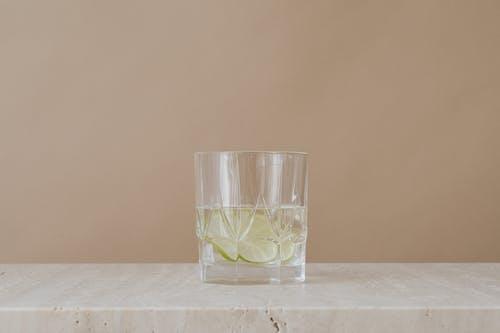 Clear Drinking Glass With Water and Lime