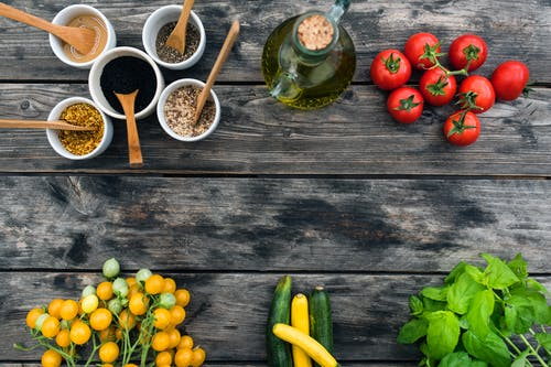 Fresh ingredients for salad placed on wooden table